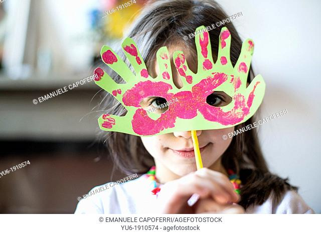 portrait of a child with carnival mask