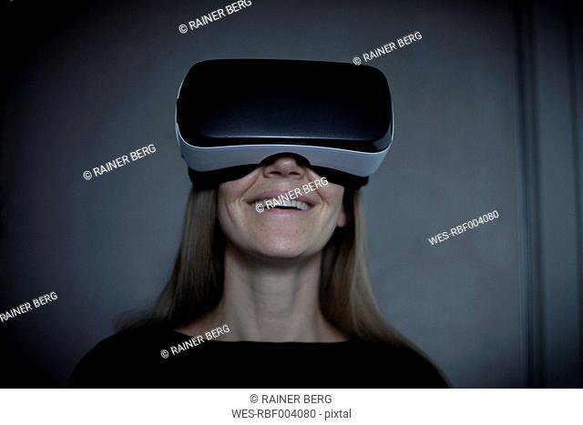 Smiling woman wearing Virtual Reality Glasses
