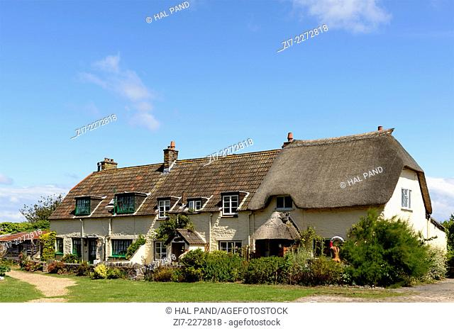 old terrace houses at Porlock Weir, Somerset, view of old houses in historic touristic village of Somerset. Shot in bright light