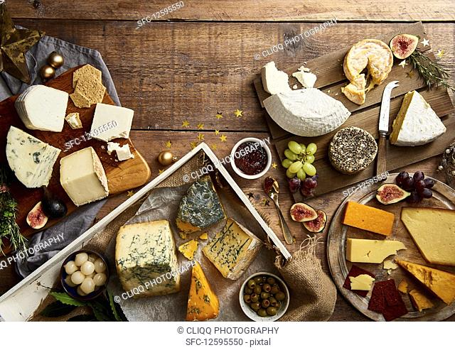 Selection of cheeses with fruit, crackers, herbs and chutney