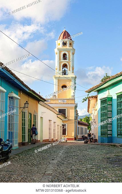Cobbled street and houses with Sao Francisco Church, Trinidad, Cuba
