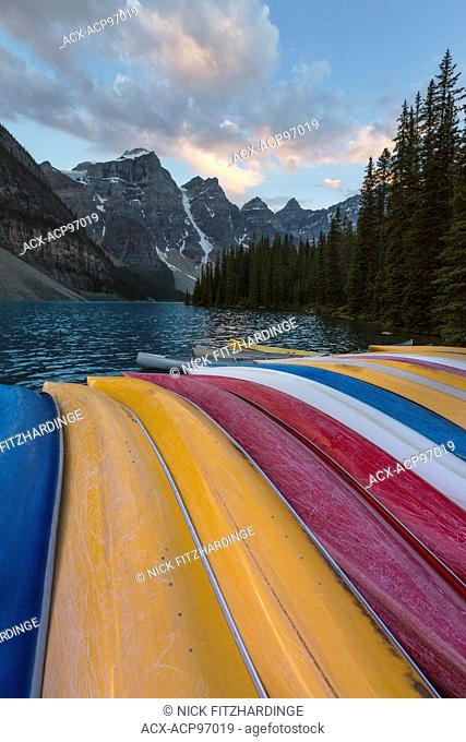 Stacked canoes at the end of the day, Moraine Lake, Alberta, Canada