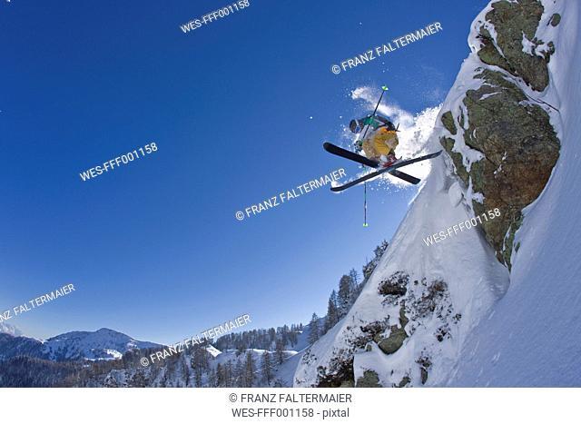 Austria, Tyrol, Kitzbuehel, Mature man doing freestyle skiing