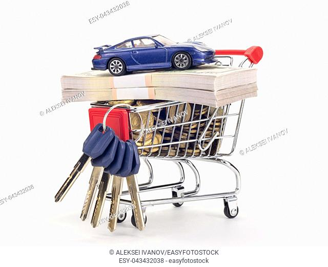 In the grocery cart of the store are coins, wads of money, keys to the apartment and car