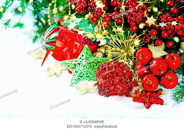 Christmas decoration red gold green over white background. Vibrant colors. Vintage style toned picture