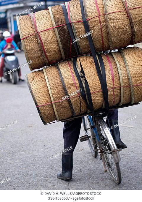 Loads piled up on bicycles for delivery in Hue, Vietnam