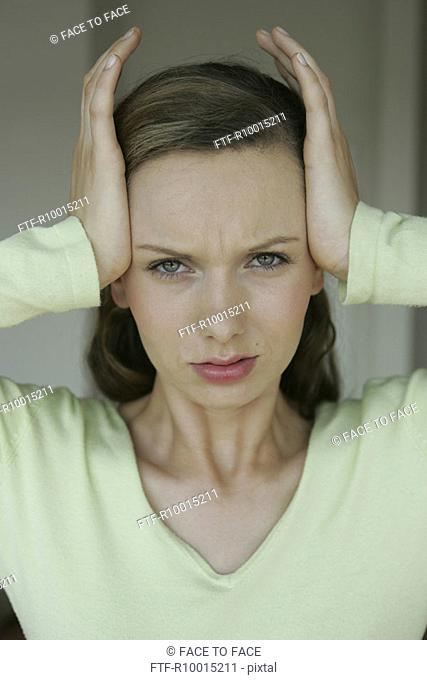 A blonde woman suffering from severe headache