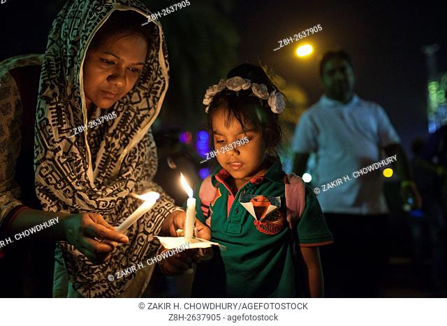 DHAKA, BANGLADESH - MARCH 26 : Thousand of people lit candles at Manik Mia Avenue on the eve of the 45th Independence Day in memory of the martyrs of the...