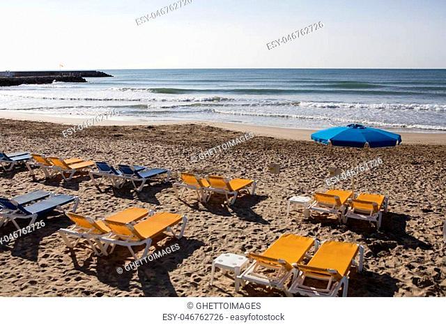 beach lies on the beach of Sitges, Spain, April 7, 2016
