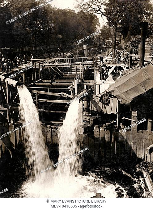 An unidentified civil engineering project, with water gushing out of two large pipes
