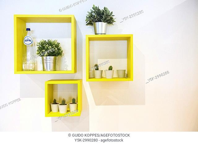 Tilburg, Netherlands. Interior decoration cubes on a fashion store wall, giving a domestic ambiance and support sales