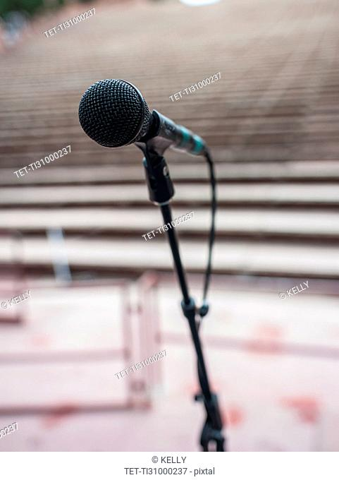 Microphone and empty amphitheater