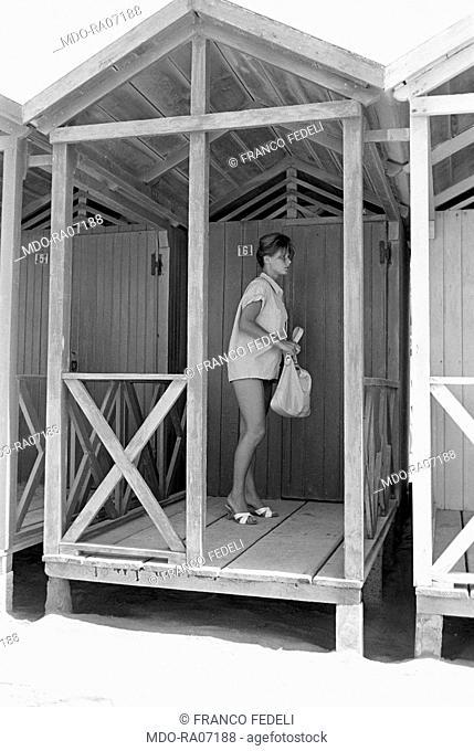 Italian actress Marisa Allasio leaving her bathing hut at the beach. Versilia, 1960
