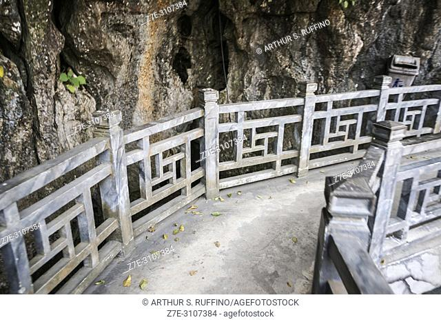 Ornate rail along pathway from pier to steps leading to entrance of Dau Go Cave, Dau Go Island. Ha Long Bay, UNESCO World Heritage Site, Quang Ninh Province