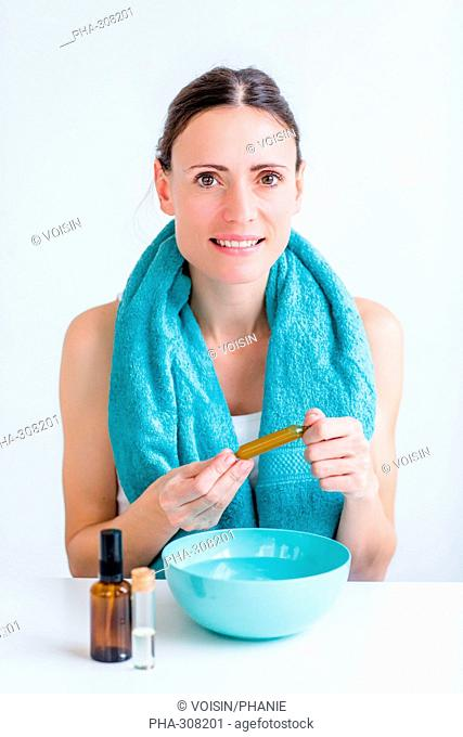 Woman treating a nasal congestion with an inhalation