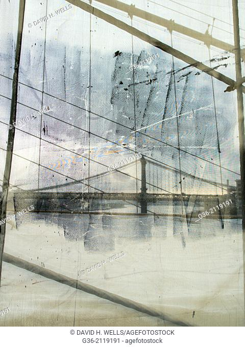 Steel cable, grafiti and netting on Brooklyn Bridge, in New York, New York
