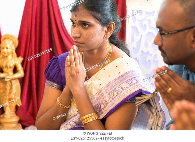 People pray during praying events. Traditional Indian Hindus ear piercing ceremony. India special rituals