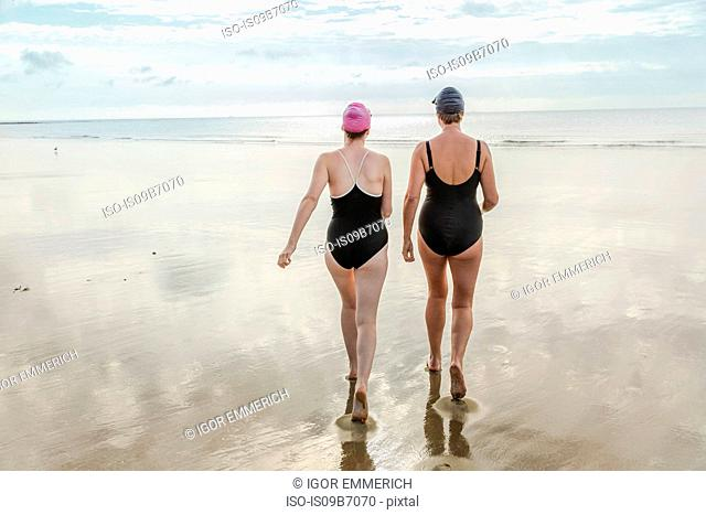 Mother and daughter heading to sea, Folkestone, UK