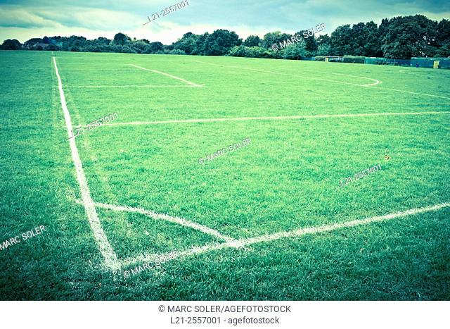 Football soccer field corner with white marks in a park. London, England, United Kingdom