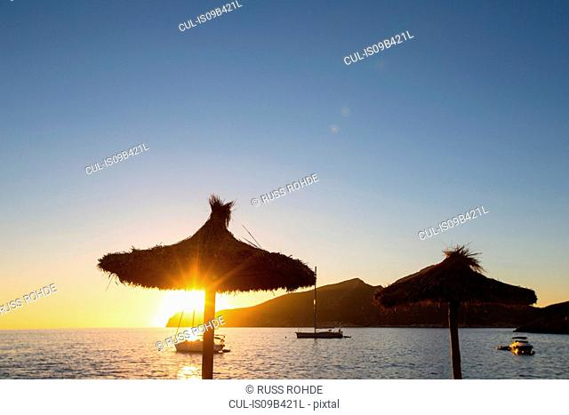 Silhouetted view of anchored yachts and Dragonera Island from Sant Elm, Majorca, Spain