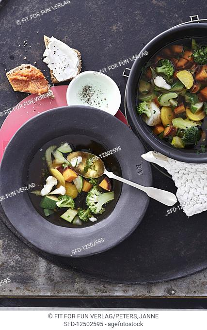 Colourful vegetable soup with broccoli