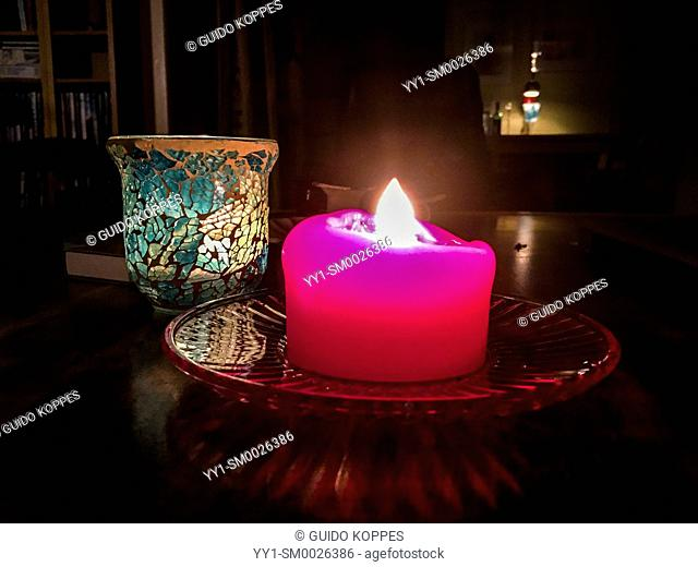 Tilburg, Netherlands. Burning candles on a living room tabale during the darkest days of the year, just before Christmas