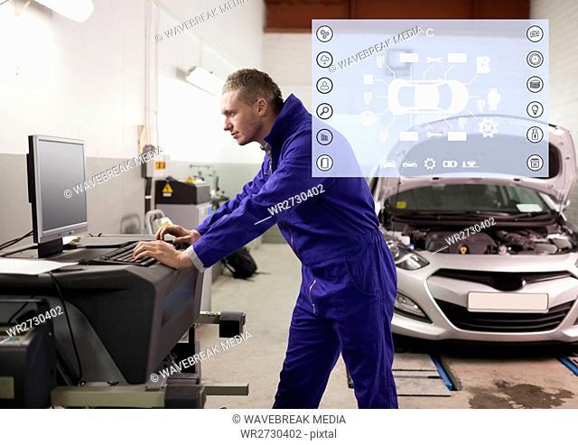 Mechanic using desktop pc at garage