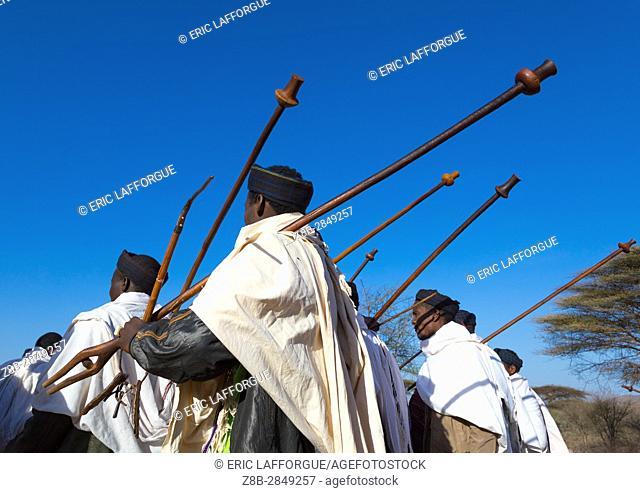 Borana tribe men with their ororo sticks during the Gada system ceremony, Oromia, Yabelo, Ethiopia