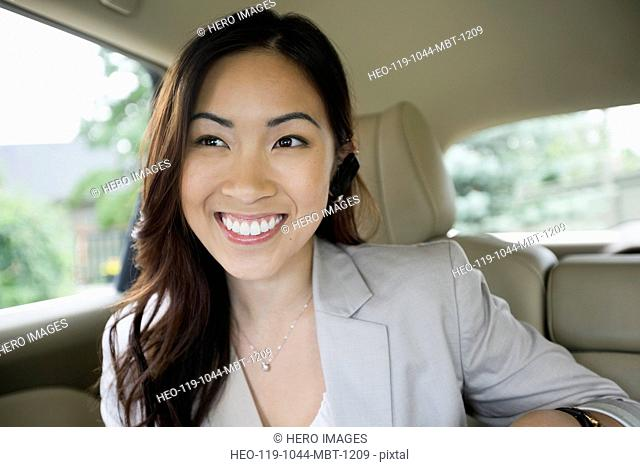 Beautiful businesswoman smiling in car