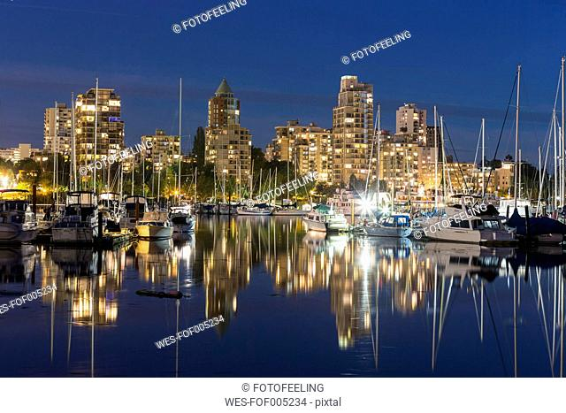 Canada, Vancouver, Marina with ships and skyline at night