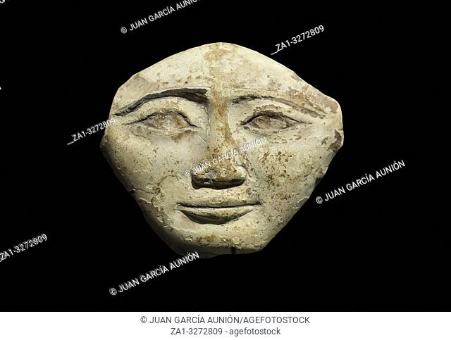 Egyptian Ancient polychrome terracotta mask. Isolated over. Ifergan Collection