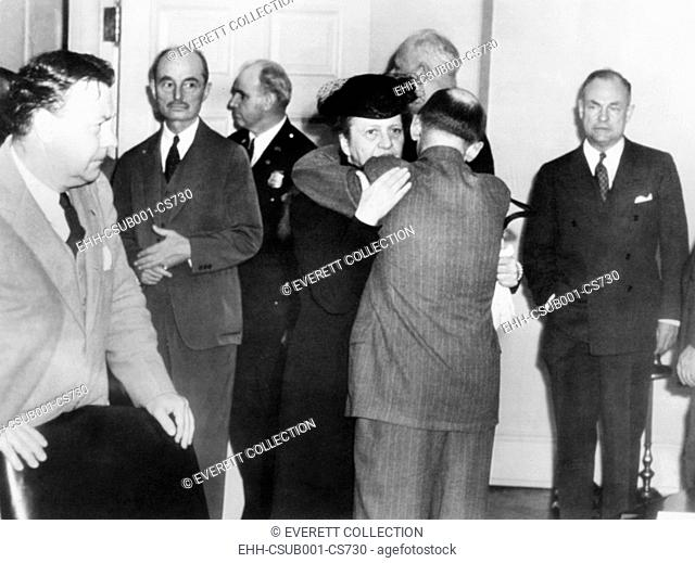 Secretary of Labor Frances Perkins in grief over the President's Franklin Roosevelt's death. April 12, 1945. She embraces Isidor Lupin