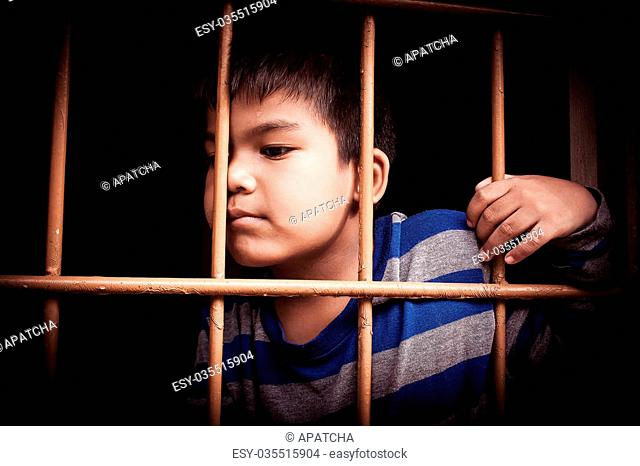 asian boy Hand in jail,vintage tone
