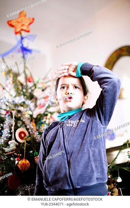 Portrait of child front of Christmas tree