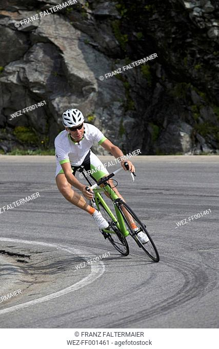Switzerland, Engadin, cyclist on Bernina Pass