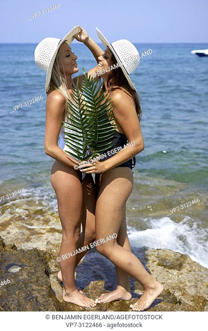 Two young women on the beach. Chersonissos, Crete, Greece