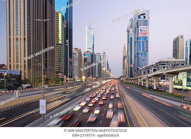 Evening view of skyscrapers and traffic along Sheikh Zayed Road in Dubai United Arab Emirates