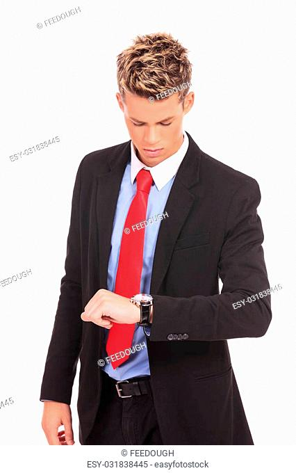 Businessman checking the time on his wristwatch