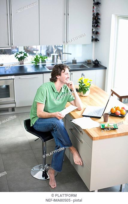 Mid adult man working from home