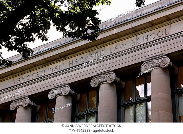 """An angled shot of the letters """"""""LANGDELL HALL HARVARD LAW SCHOOL"""""""" on the front of Harvard law school's main library building in Cambridge, MA"""