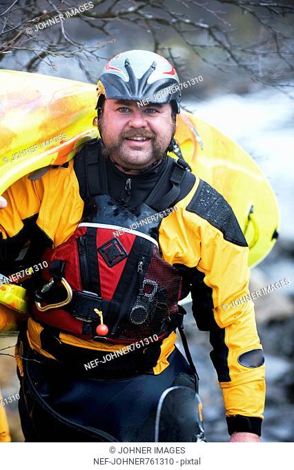 Man carrying his kayak, Sweden