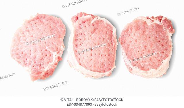 Three Raw Pork Schnitzels Isolated On White Background