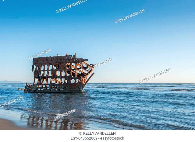 Tide Comes In Over Petere Iredale Wreck along northern Oregon coast
