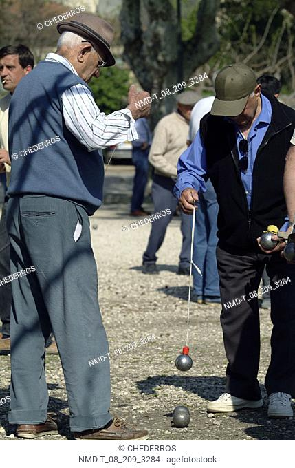 Two senior men playing boules, Provence, France