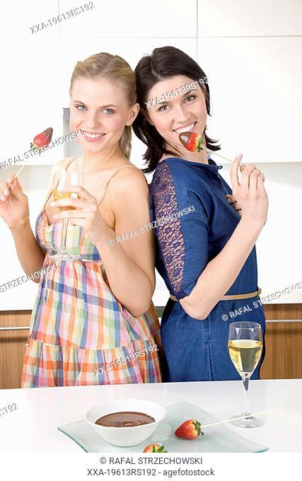 Woman eating fruit fondue