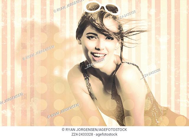 Old style edit of a hot pin up model with wind swept fringe on summer wallpaper background. Vintage female portraits