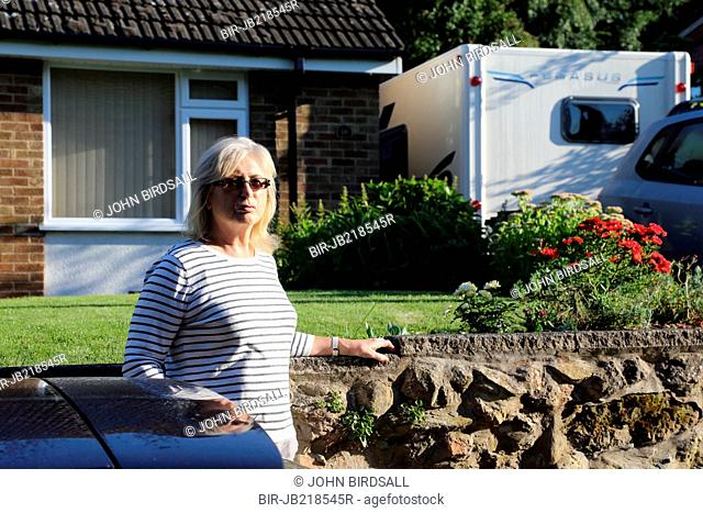 Woman outside bungalow