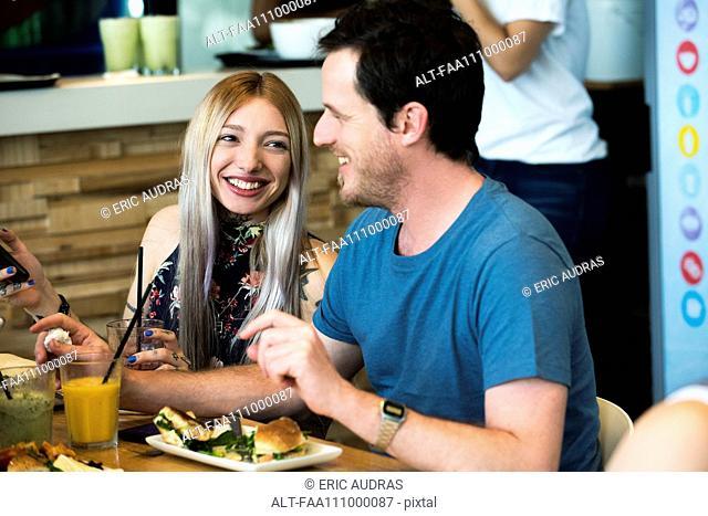 Friends having meal together at restaurant