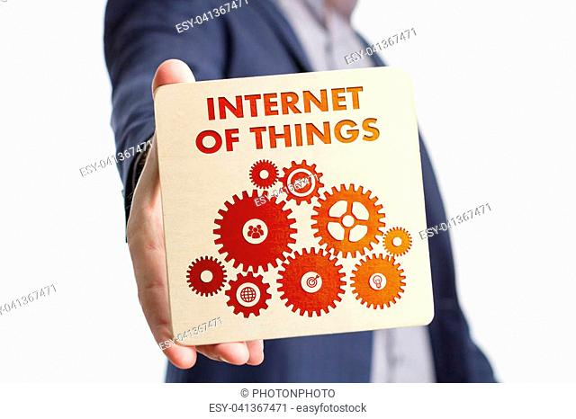The concept of business, technology, the Internet and the network. Young businessman showing inscription: Internet of things