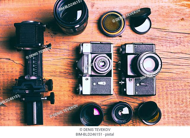 Cameras and lenses on wooden table